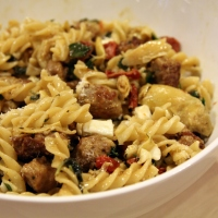 Fusilli with Sausage, Artichokes, and Sun-Dried Tomatoes [recipe]