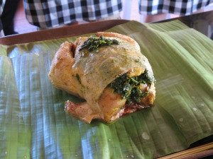chicken stuffed with spinach, about to be wrapped in banana leaf and roasted.